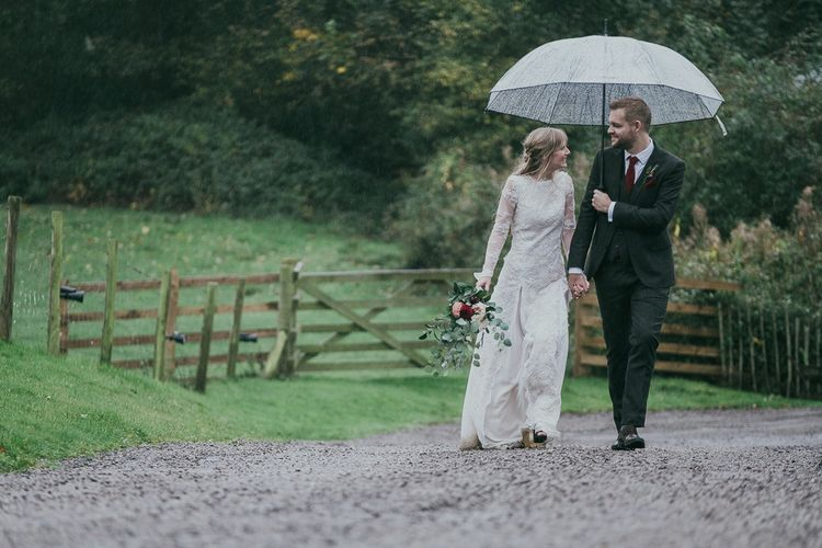 Bride and Groom Portrait with Clear Umbrella