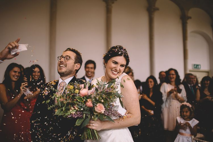 Bride and Groom Laughing During Confetti Moment