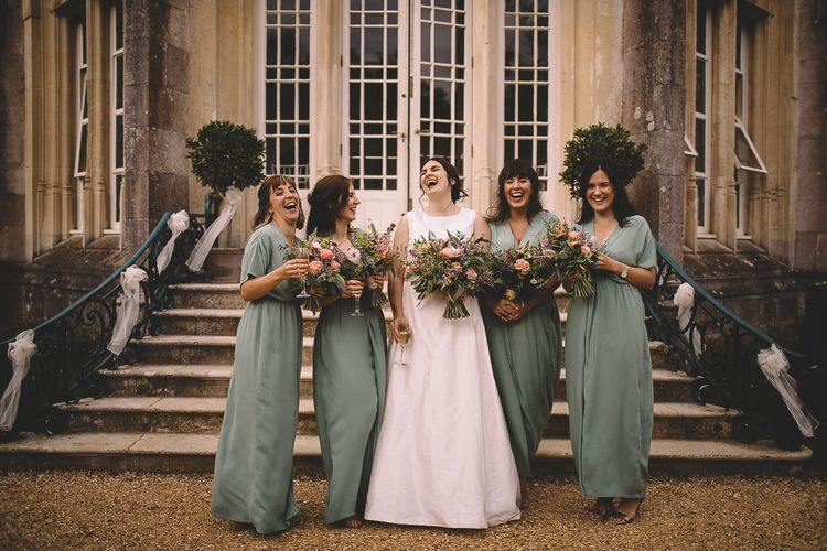 Bride in Homemade Wedding Dress and Bridesmaids in  Green Wrap Dresses from & Other Stories