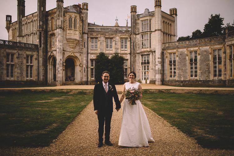 Bride and Groom in Front of Highcliffe Castle in Dorset