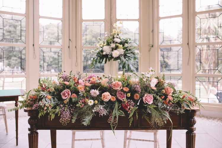 Wedding Floral Arrangement with Foliage and Pink and Peach Roses