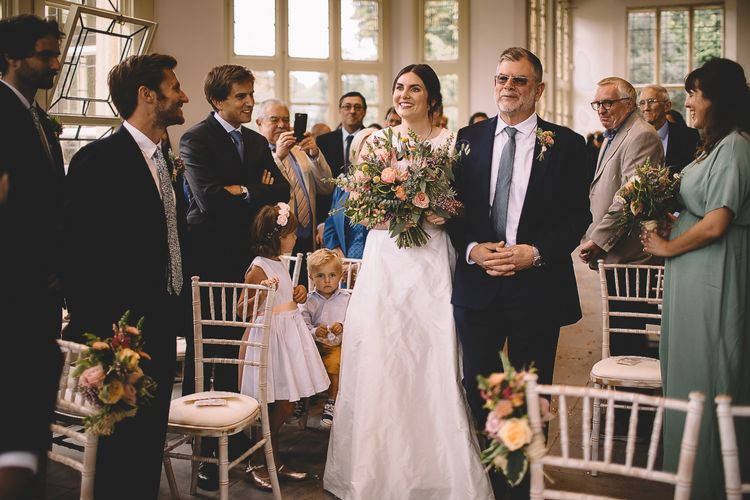 Wedding Ceremony Bridal Entrance with Bride in Homemade Wedding Dress and Protea Wedding Bouquet