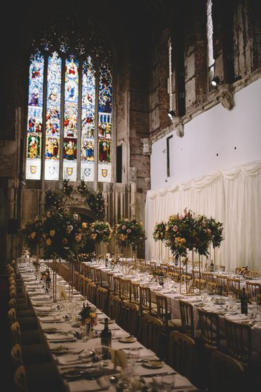Wedding Reception at Highcliffe Castle with Stain Glass Windows and Tall Centrepieces