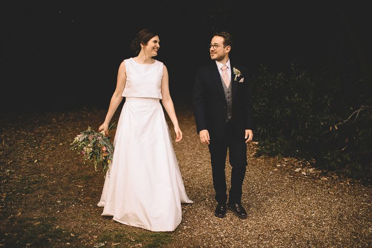 Bride in Homemade Wedding Dress with Layered Top and Bow Back and Groom in Dress2Kill Suit