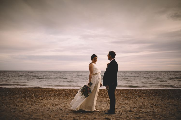 Coastal Portrait of Bride in Homemade Wedding Dress with Bow Back and Groom in Dress2Kill Suit