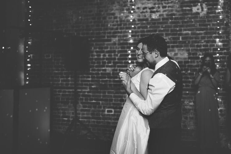 Bride and Groom Dancing with Fairylight Backdrop
