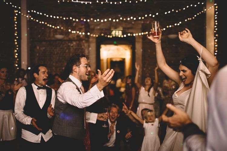 Bride and Groom Dancing at Evening Reception with Fairylight Backdrop