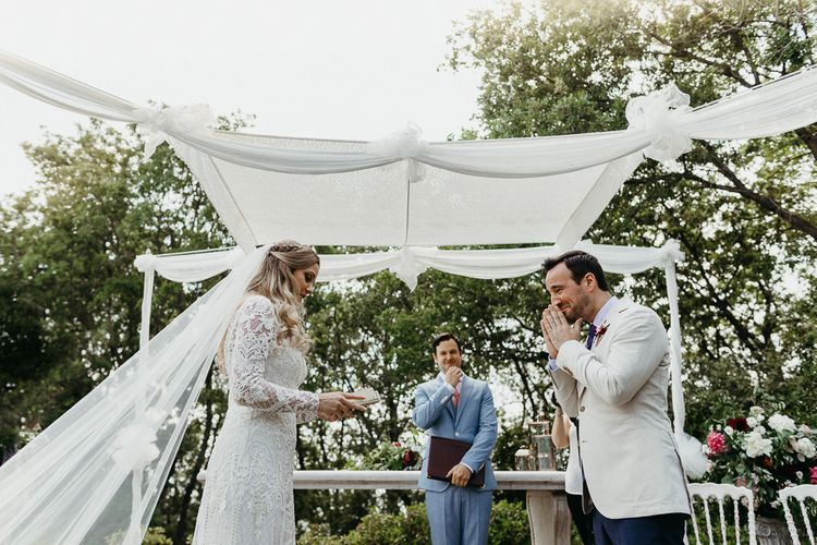 Emotional Bride and Groom Exchanging Vows at Outdoor Wedding Ceremony