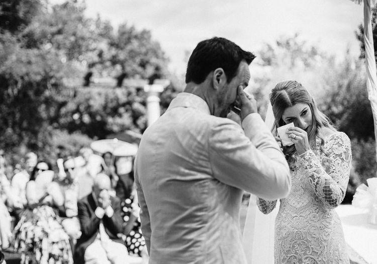 Emotional Bride and Groom Wiping Away Tears