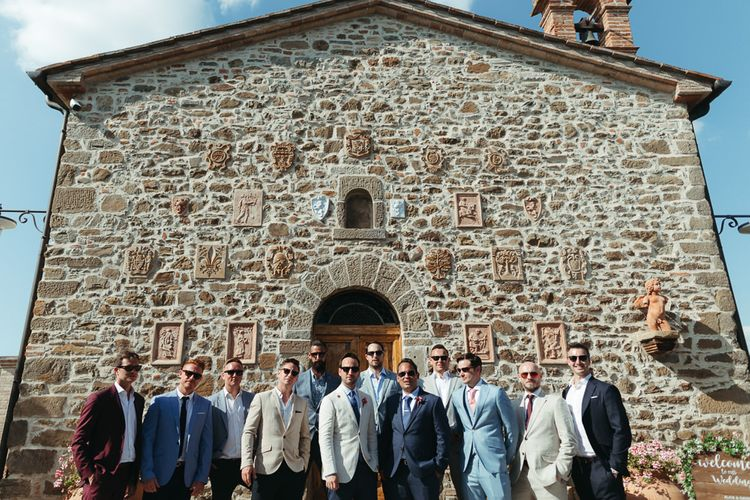 Groomsmen in Different coloured Suits and Sunglasses