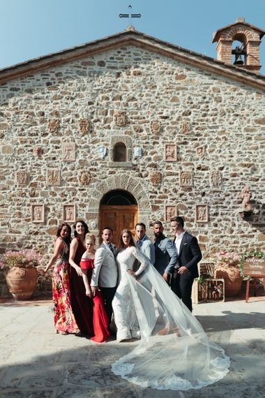 Bride and Groom Portrait with Wedding Guests