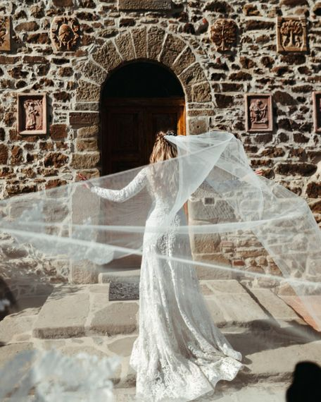 Lace Edged Cathedral Length Veil Blowing in the Wind