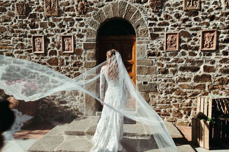 Bride in Fitted Lace Wedding Dress by Zuhair Murad with Long Sleeves