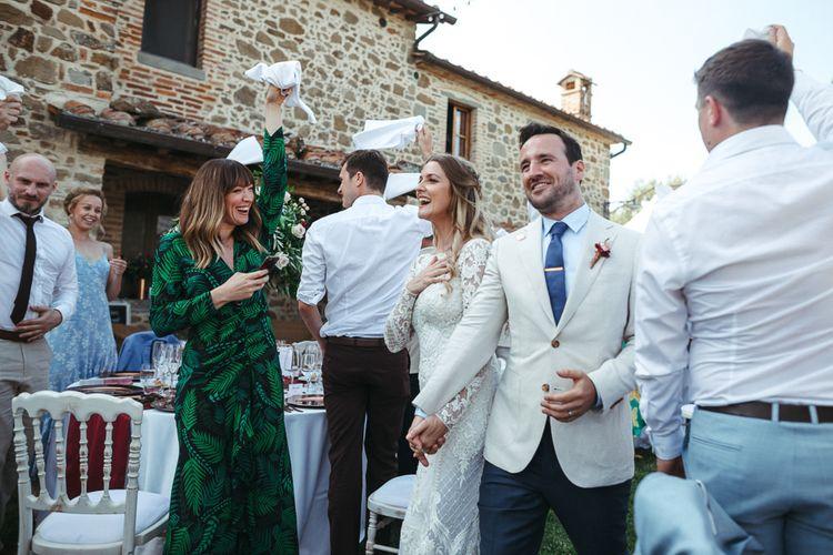 Bride and Groom Entering Their Outdoor Wedding in Umbria Reception