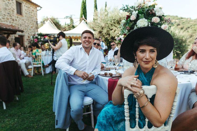 Stylish Wedding Guests in Chandelier Earrings and Felt Hat