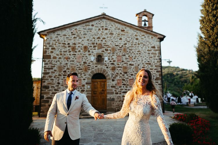 Bride in Lace Wedding Dress with Long Sleeves and Groom in Beige Blazer