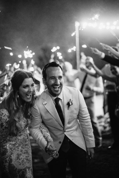 Black and White Portrait of Bride and Groom at Sparkler Exit