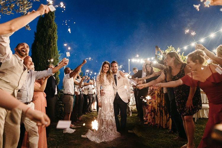 Sparkler Exit with Bride in Lace Dress and Groom in Beige Blazer