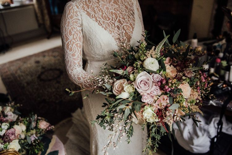 Bride wearing Karen Willis Holmes Bridal with wild flowers