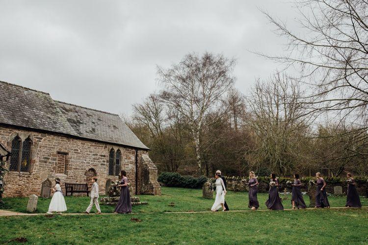 Bride and bridesmaids walking into church