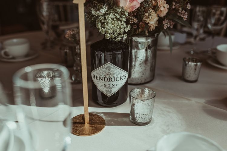 Gin Bottles For Wedding Table Decor // Bride In Bouret Separates For An Autumn Wedding At Old Brook Barn With Bridesmaids In Black Reiss Dresses And Images From Jess Soper Photography