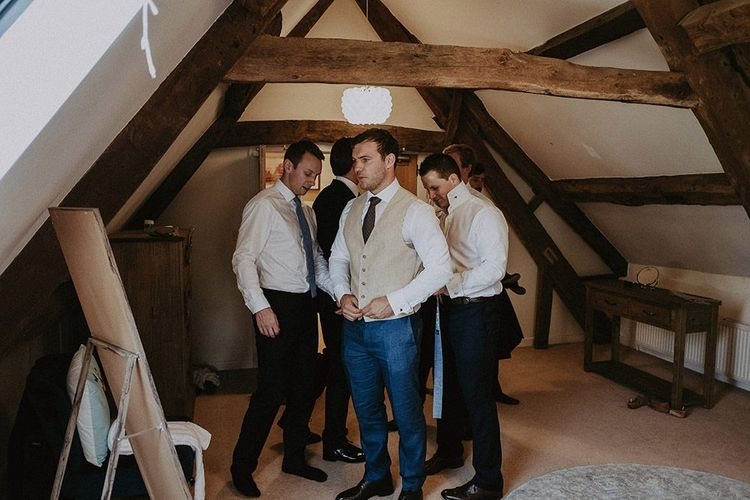 Groom and Groomsmen Getting Ready Before Ceremony