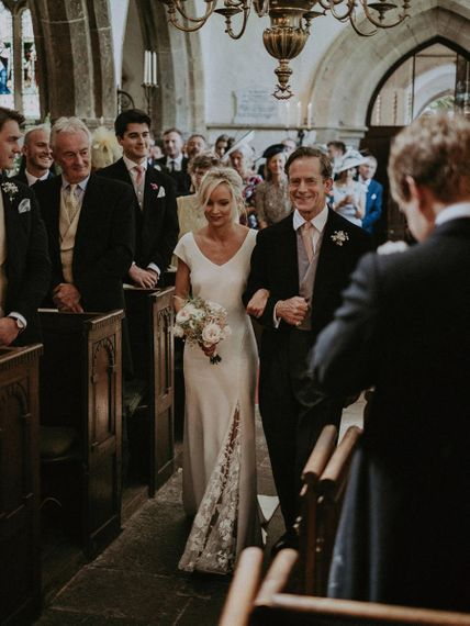 Bride Walking Down The Aisle For Church Ceremony