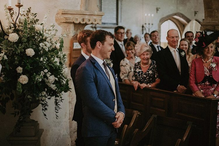 Groom Waiting For Bride During Church Wedding Ceremony
