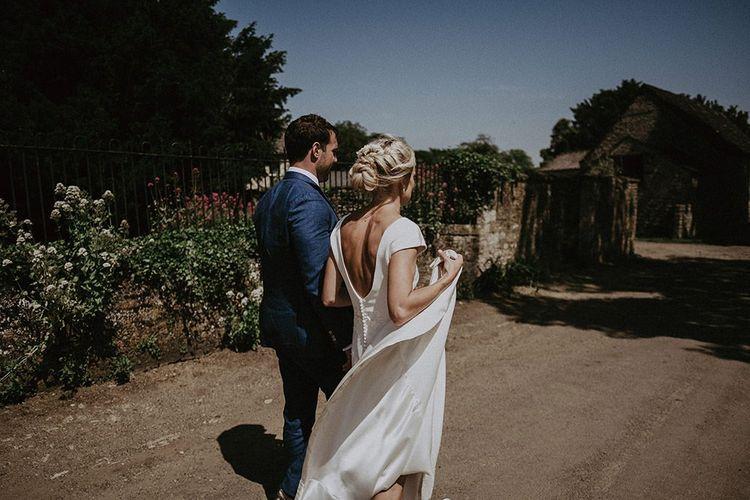 Low Back Wedding Dress With Bridal Plait Up Do