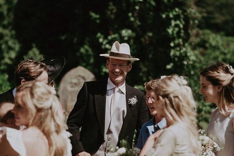 Guest Wearing Hat In Hot Sun