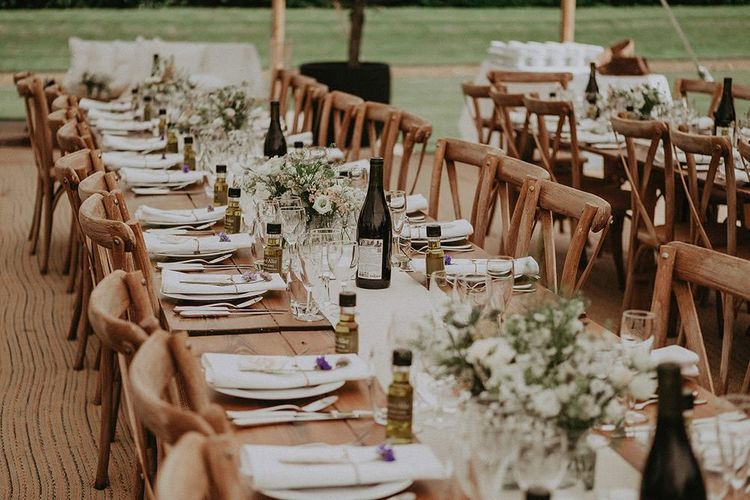 Long Wedding Table Set Ups With White  Flowers
