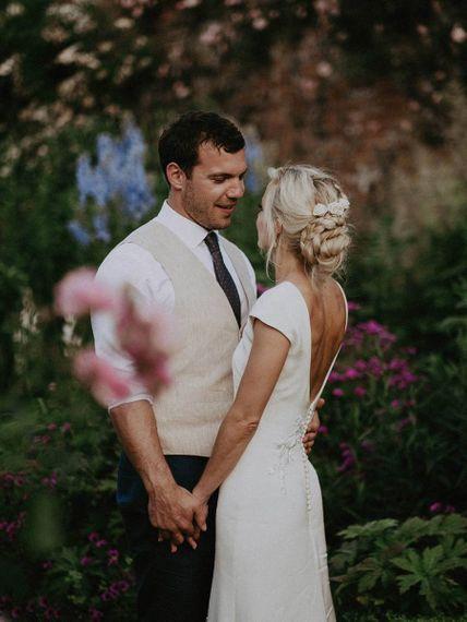 Low Back Wedding Dress with Groom in Cream Waistcoat