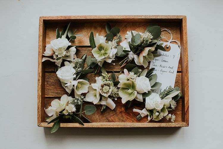 Wooden Tray of White and Green Buttonholes