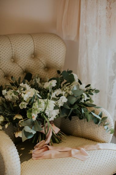 White Flower and Foliage Wedding Bouquet with Pink Ribbon
