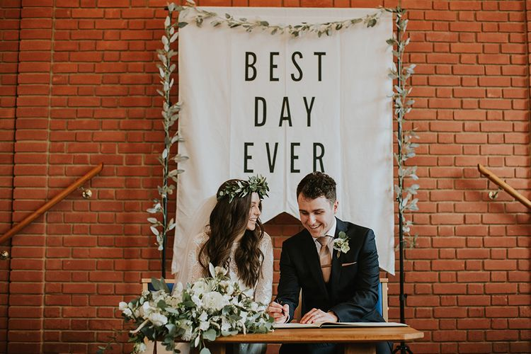Church Wedding Ceremony with Bride and Groom Kissing Signing Register in Front of Best Day Ever Sign