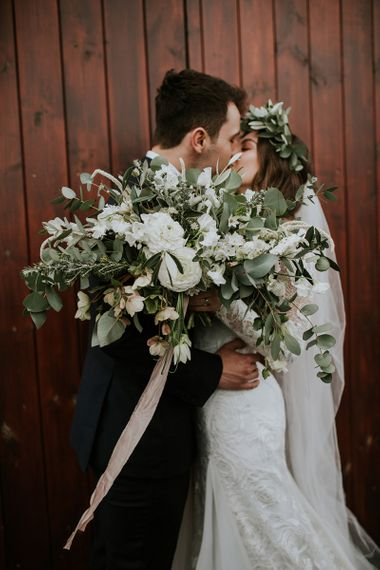 Oversized White Flower and Greenery Wedding Bouquet