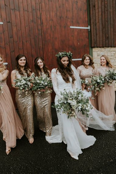 Boho Bride in Grace Loves Lace Wedding Dress with Her Bridal Party in Blush Pink and Gold Sequin Dresses