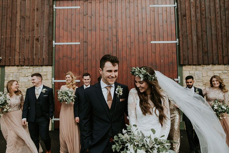 Bride Long Sleeve Grace Loves Lace Wedding Dress and Groom in Moss Bros. Suit with Their Wedding Party