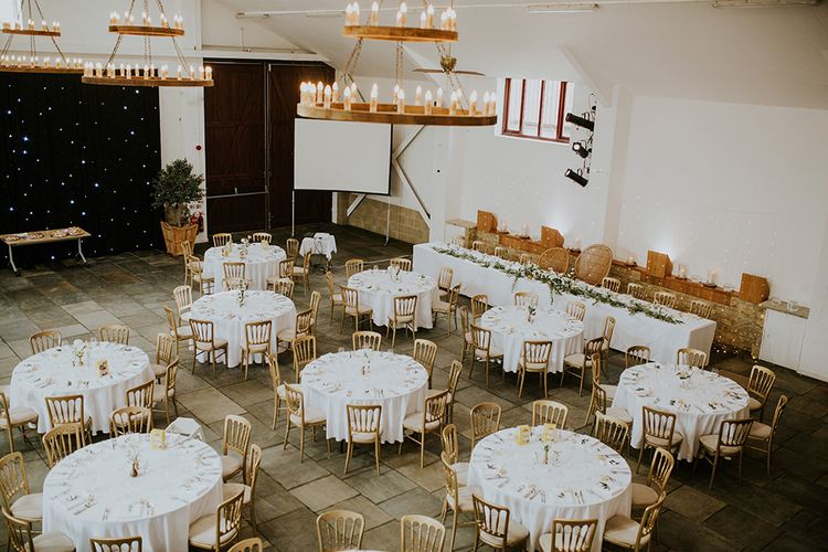 Wedding Reception Decor with Gold Chairs