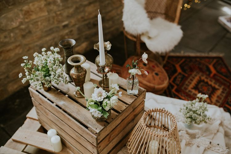 Wooden Crate Wedding Decor with Gold Candles Sticks and White and Green Flowers