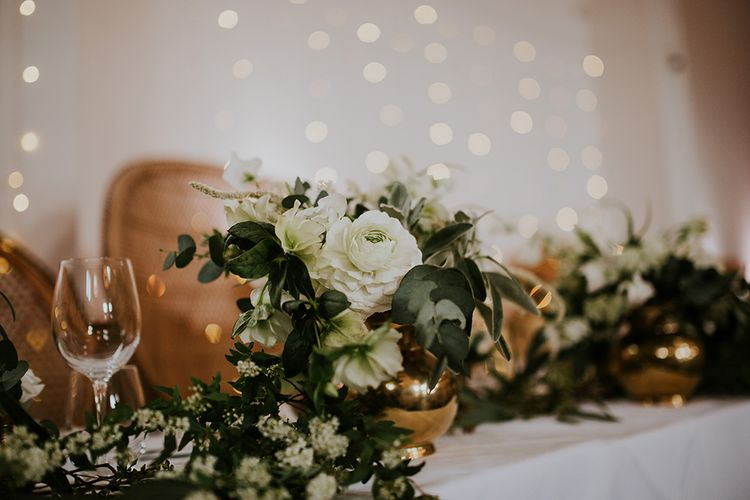Top Table White and Green Wedding Flowers in Gold Vessel