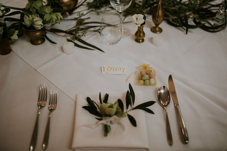 Elegant Place Setting with Sugared Almonds and Fresh Flower Stem
