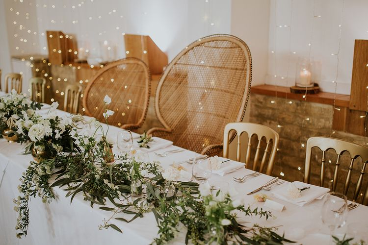 Top Table with Peacock Chairs, Greenery Table Runner and String Lights