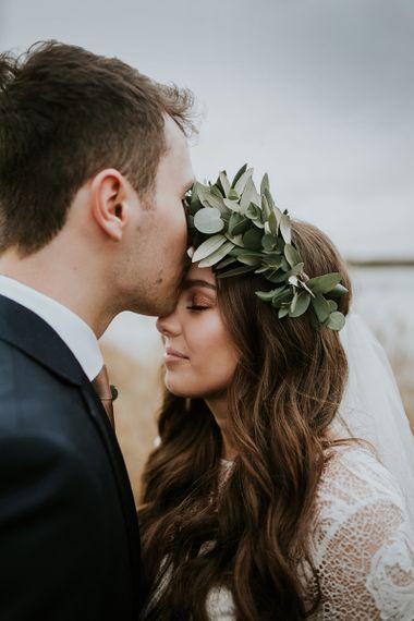 Groom Kissing His Brides Forehead