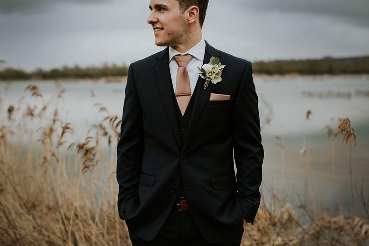 Groom in Moss Bros Suit
