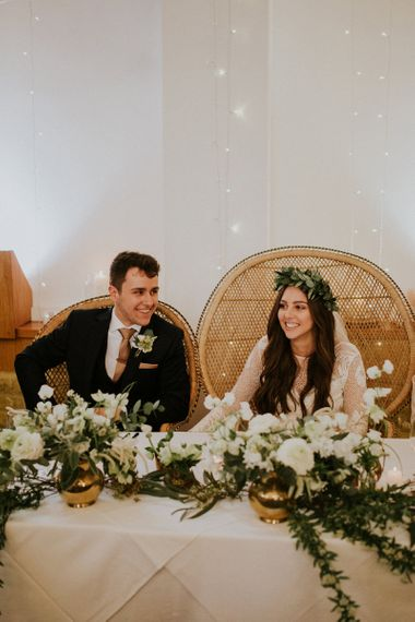 Bride in Long Sleeve and Backless Grace Loves Lace Wedding Dress and Groom in Moss Bros. Suit During the Wedding Reception Speeces