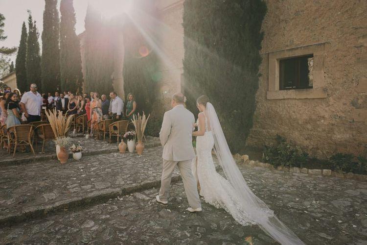 Bride walks down the aisle in Emmy Mae dress