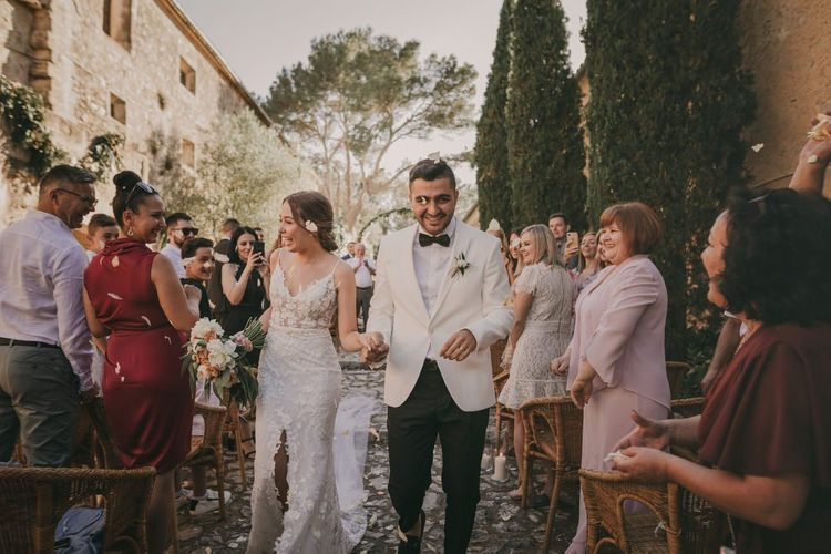 Confetti exit for bride and groom at destination wedding