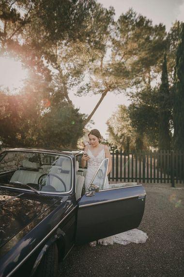 Bride gets in wedding car in Emmy Mae bride dress