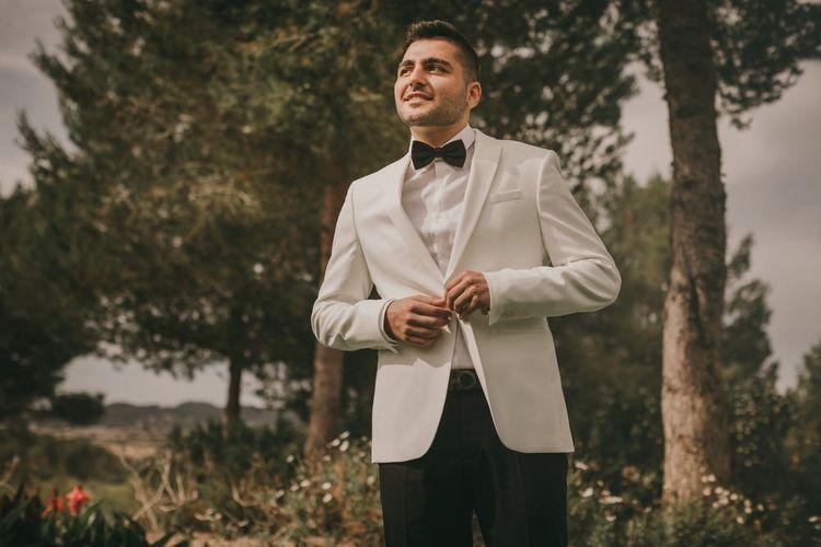 White tuxedo jacket for groom at destination wedding
